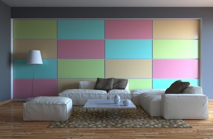 5. Tipp: Tapete mit gedeckten Farben als moderater Akzent zur CouchLandschaft in Kieselgrau