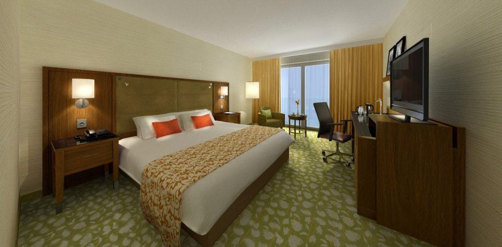 02a Das Schlafzimmer im Traumhaus: weißes Doppelbett vor Holzvertäfelung