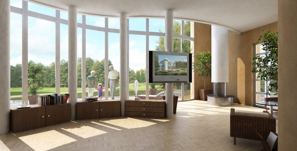 03a. Weitläufiges Wohnzimmer mit Blick über die Terrasse in den Park