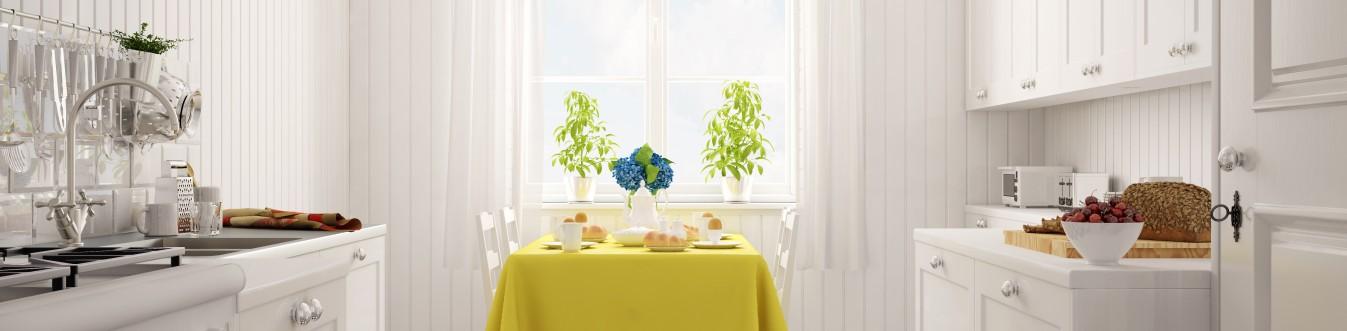 Wir Deutschen haben schon einen ausgeprägten Hang zum nordischen Stil und zum Landhausstil. Was ist beiden gemein? Sie strahlen eine angenehme Ruhe und Beschaulichkeit aus. Diese Singleküche kann das auch. Selbst die freche-frischen-Farbakzente an Tisch und Fenster können  nicht darüber hinwegtäuschen.