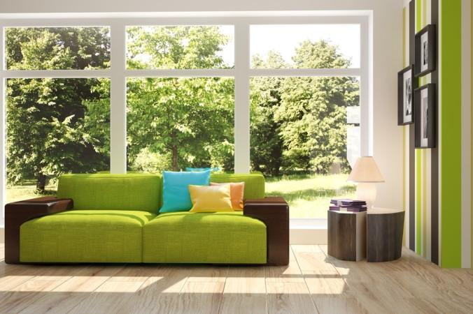 Akzente mit einer einzigen Farbe machen den Raum gemütlich. Hier wirkt das Grün in Komibnatiion mit der direkten Natur sehr freundlich und harmonisch. (#5)