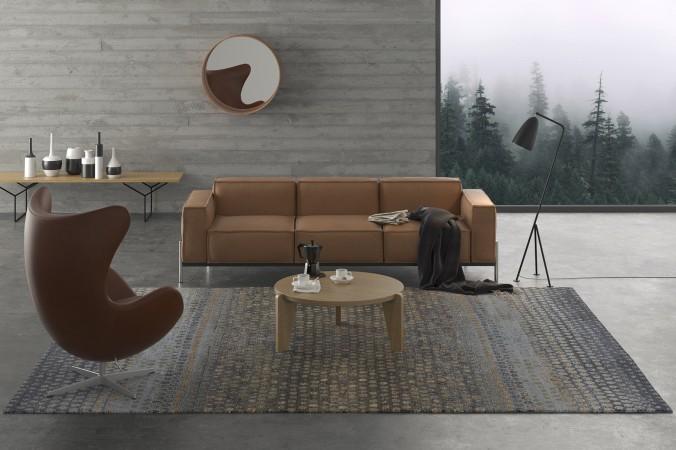Wer behauptet, dass man Grau und Braun nicht kombinieren kann, der wird hier eines besseren belehrt. Ganz harmonisch fügt sich der wunderschöne Teppich mit seinem Punktemuster ein. Braune Möbel machen das Ganze richtig schick.