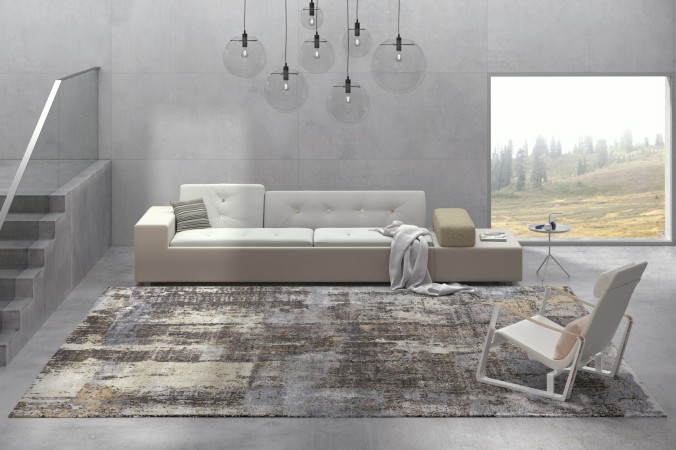 Ein optisches Hightlight ist dieser schöne Teppich in weiß, beige, grau und braun. Er erinnert entfernt an ein Gemälde. Zeit zum Wohlfühlen, in dem ansonsten eher clean gestalteten Wohnzimmer.