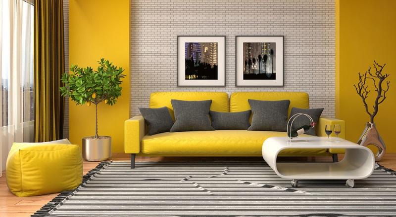 Ein kräftiges Gelb ist ein wunderbarer Kontrast zu Grau und bringt ein wenig Spannung in den Raum.